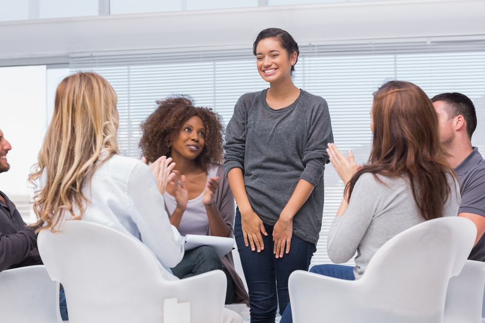 Patient has a breakthrough in group therapy and everyone is clapping her.jpeg