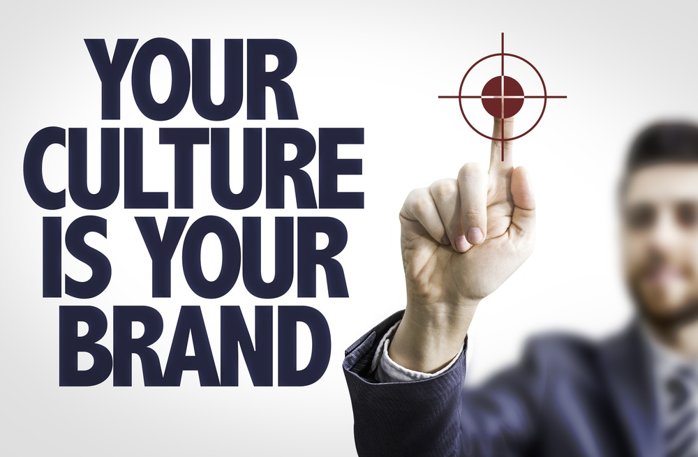 Business man pointing the text Your Culture is Your Brand.jpeg