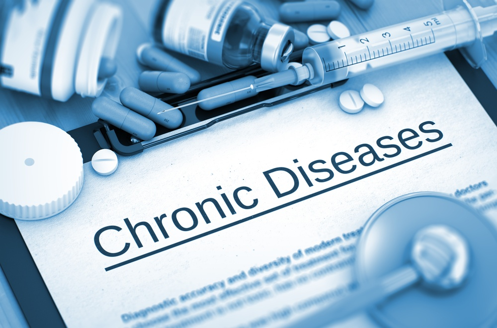 Chronic Diseases on Background of Medicaments Composition - Pills, Injections and Syringe. Chronic Diseases - Printed Diagnosis with Blurred Text.  Toned Image. 3D Render..jpeg
