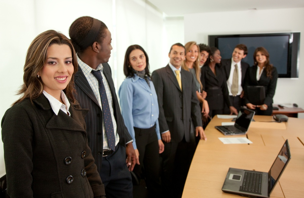 Large business group in a conference smiling.jpeg