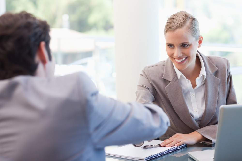 Manager interviewing a male applicant in her office