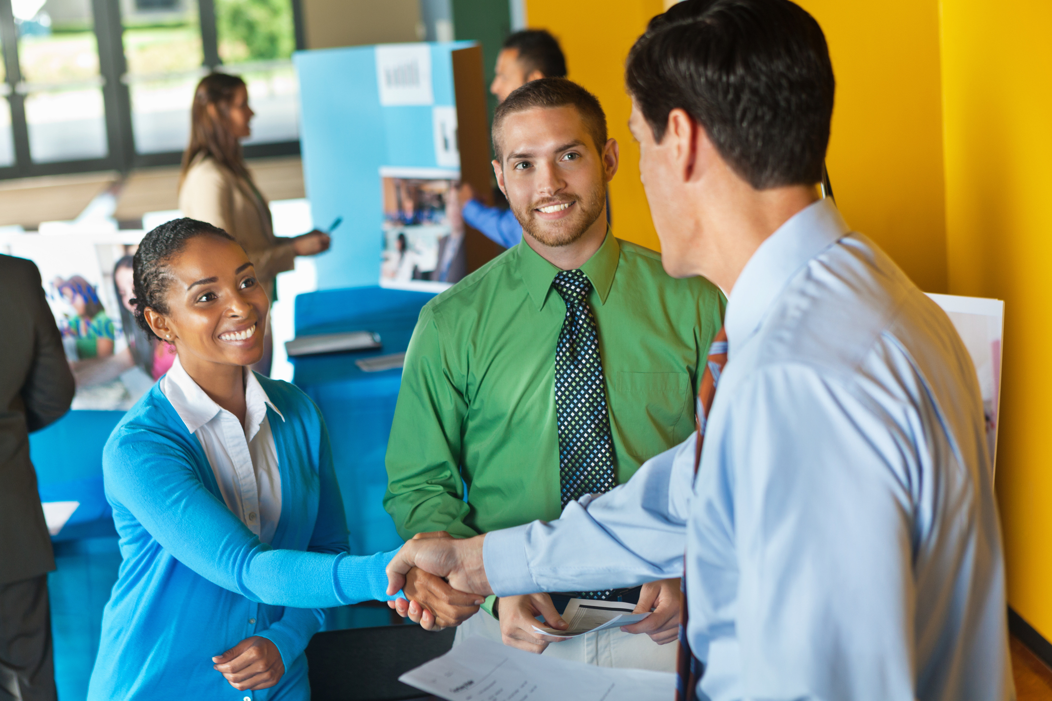 shaking hands at a job fair