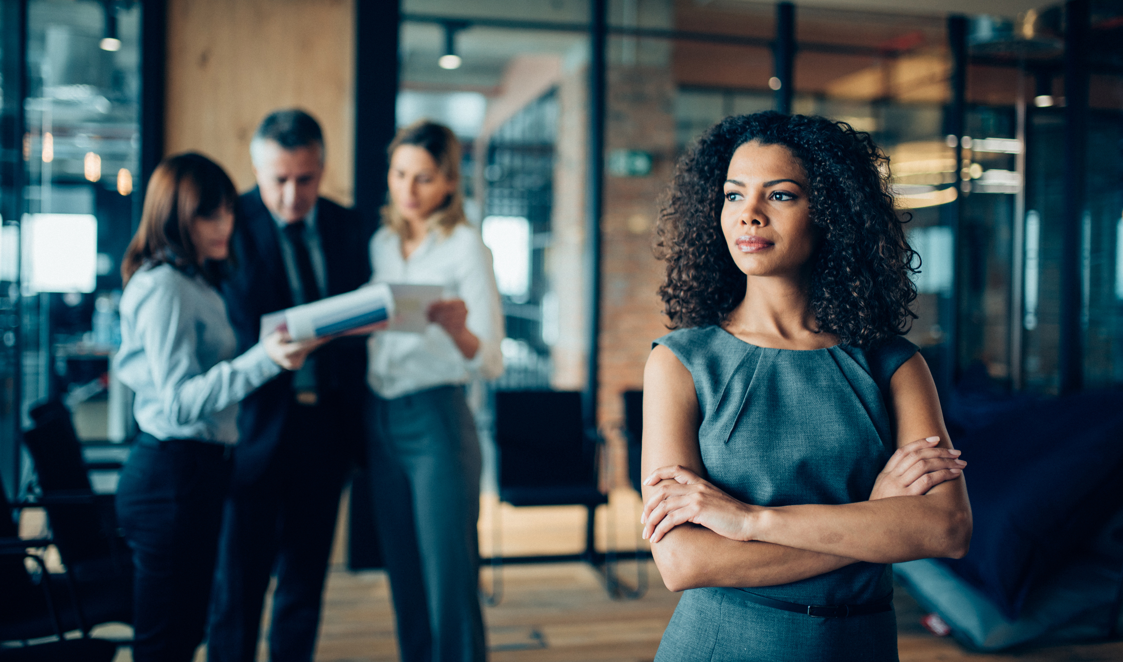 Woman in the workplace thinking of a big decision