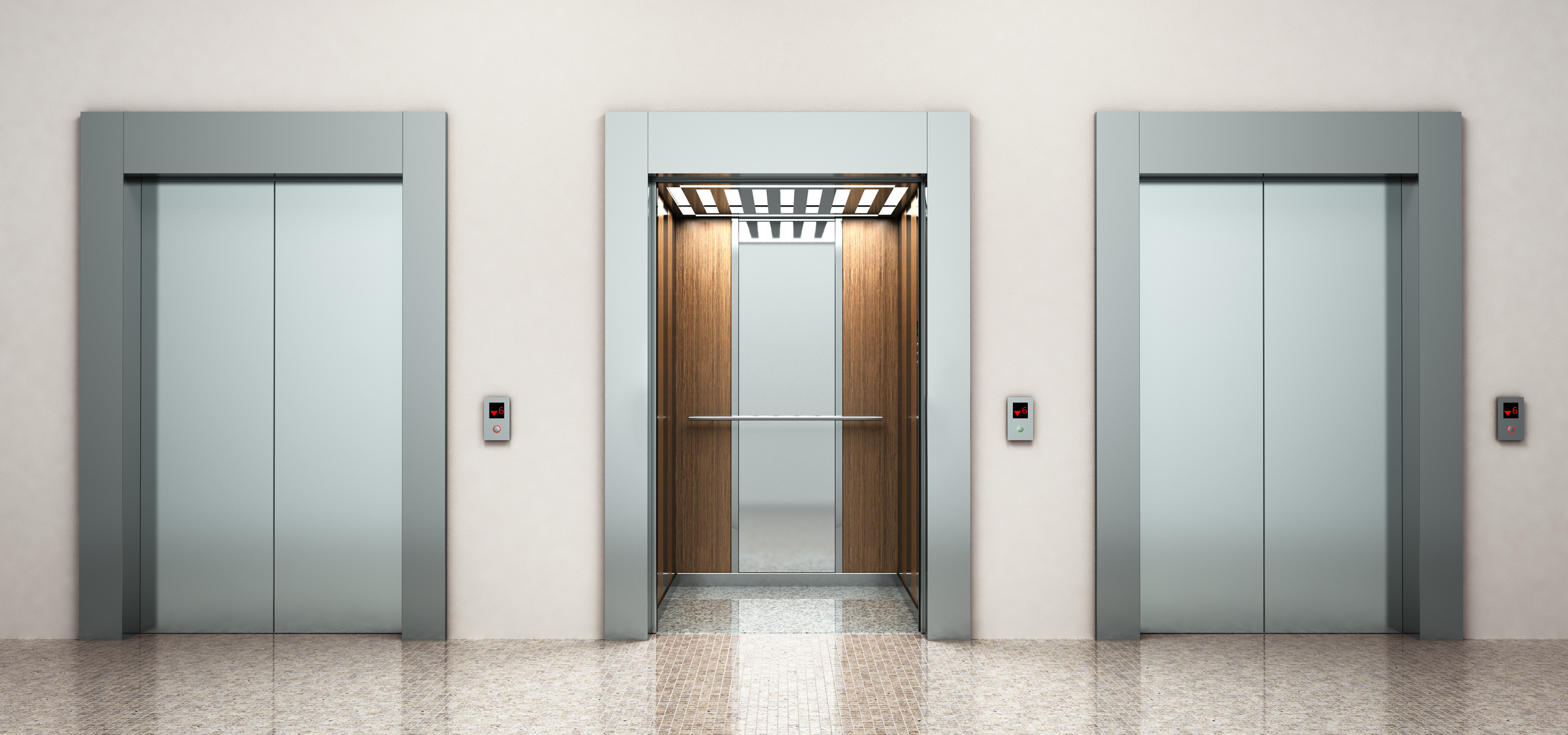 Three elevators, middle elevator has its doors open, while the two on either side are closed