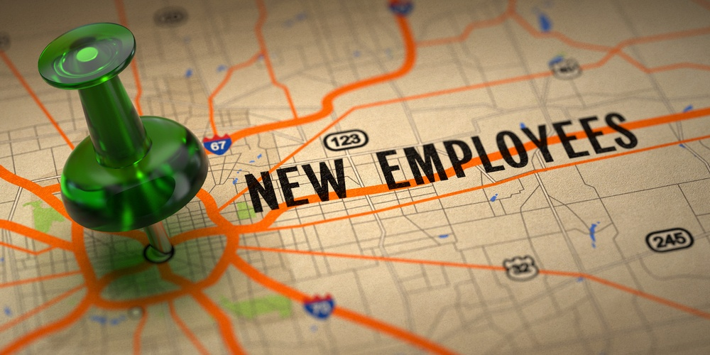 New Employees Concept - Green Pushpin on a Map Background with Selective Focus..jpeg